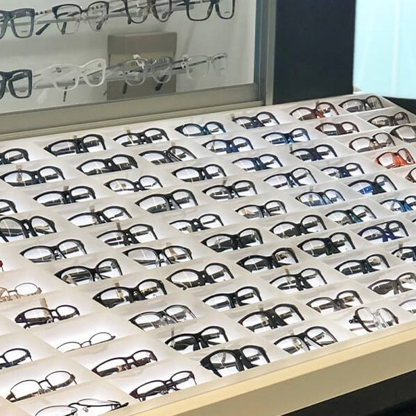 Up-lit retail display for glasses by C-West Custom Fixtures